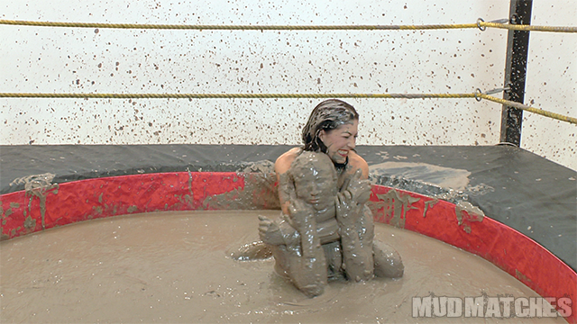 Kym chokes Shauna as they mud wrestle