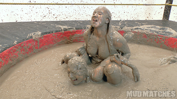 Shauna Ryanne pins kymberly Jane while mud wrestling