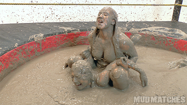 Shauna Ryanne pins kymberly Jane while mud wrestling