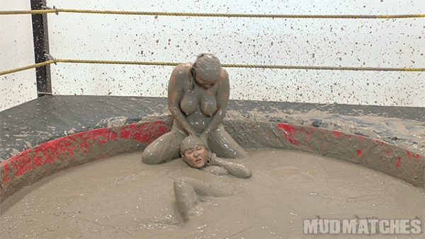 Kymberly Jane's muddy boobs are exposed as she subdues Shauna Ryanne