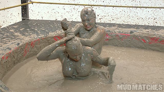 Kym grabs Shauna by the hair as the two ladies mud wrestle