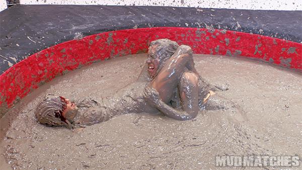 Sarah Brooke scissors hold Samantha Grace mud wrestling