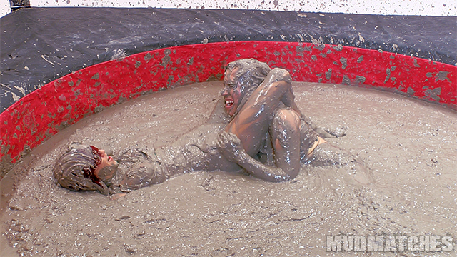 Sarah Brooke scissors hold Samantha Grace mud wrestling